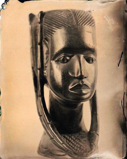 A tintype of an African sculpture from the artists home